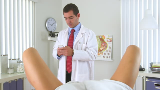 gynecologist texting  - gynecological examination stock videos and b-roll footage