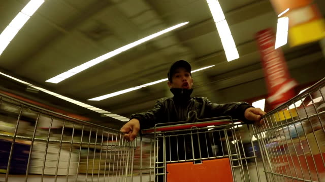 gypsy child is playing in the supermarket - shopping trolley stock videos and b-roll footage