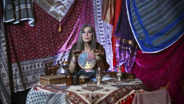 gypsy fortuneteller with faulty crystal ball - instruction manual stock videos and b-roll footage
