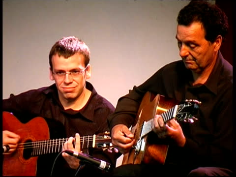 gypsy jazz guitarist fapi lafertin and rhythm guitarist performing, france - rhythm stock videos & royalty-free footage