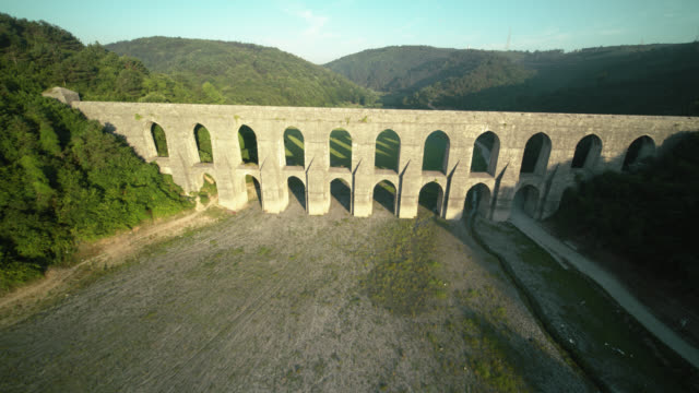 gözlüce or the güzelce / guzelce aqueduct - arco architettura video stock e b–roll