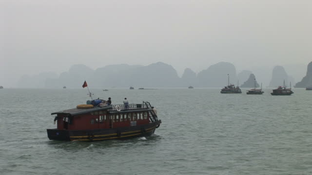 Ha Long Bay, VietnamView of a boat cruising on Ha Long Bay Vietnam
