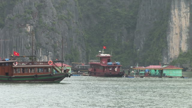 Ha Long Bay, VietnamView of a fishing village in Ha Long Bay Vietnam