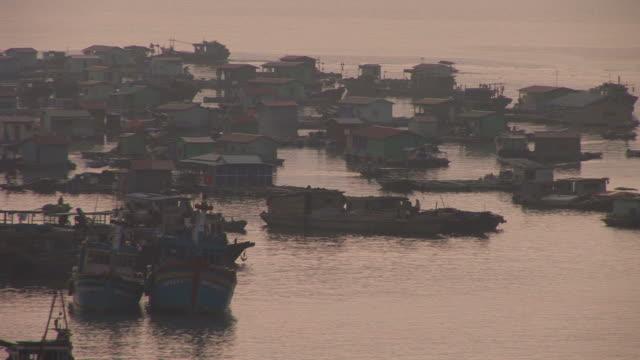 vídeos y material grabado en eventos de stock de ha long bay, vietnamview of floating houses in ha long bay vietnam - pasear en coche sin destino