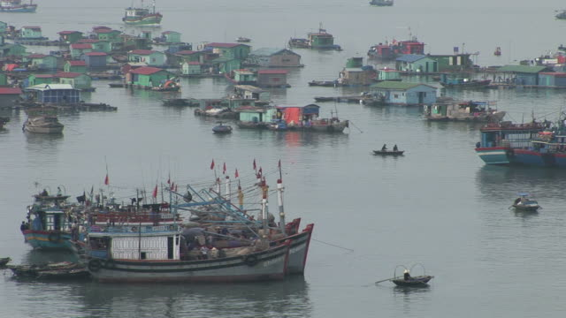 ha long bay, vietnamview of floating village in ha long bay vietnam - anchored stock videos & royalty-free footage