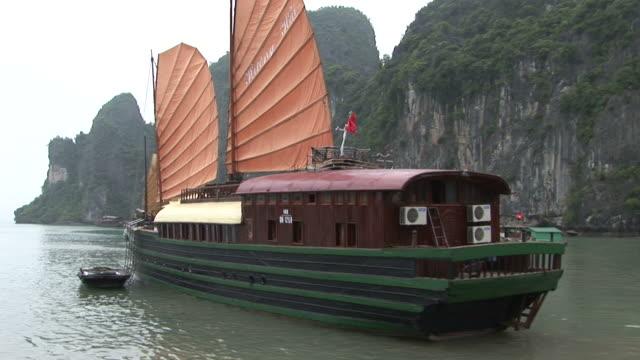 ha long bay, vietnamview of junks in ha long bay vietnam - halong bay stock videos and b-roll footage