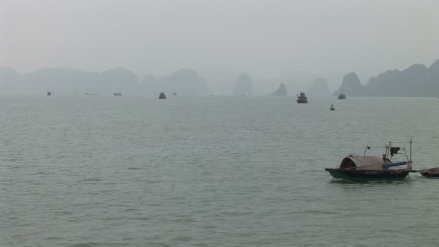 Ha Long Bay, VietnamView of small fishing boats in Ha Long Bay Vietnam