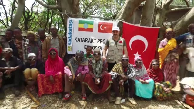 haci dursun tunc a member of the sadakatasi association's board of directors speaks in an interview about the association's cataract surgery campaign... - horn von afrika stock-videos und b-roll-filmmaterial
