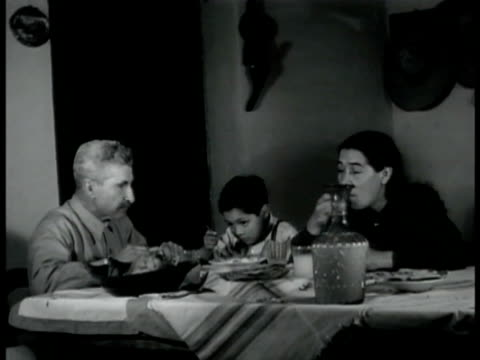hacienda farm mountains bg. int mexican family eating at table. ext mexican w/ sombrero mexican man & woman talking. girl standing up in class... - 1940 video stock e b–roll