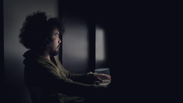 hacker cracking code using computers from his dark hacker room - hacker stock videos & royalty-free footage