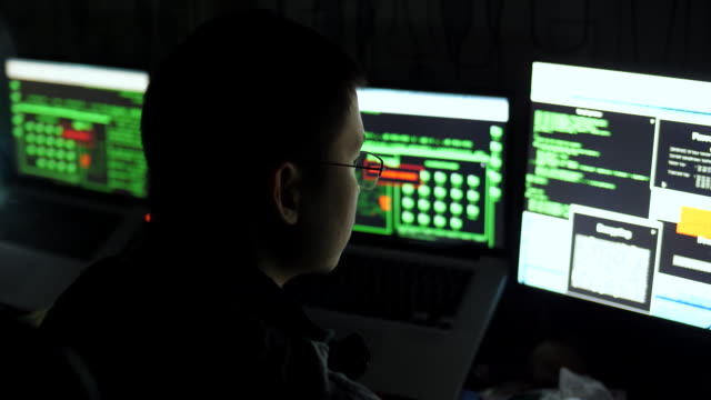 hacker cracking code using computers from his dark hacker - terrorism stock videos and b-roll footage