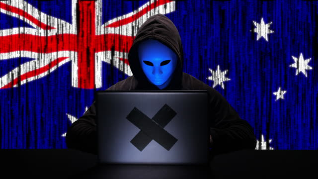 hacker hacking typing code on his laptop with australia flag and binary code animation overlay in background - tragedy mask stock videos & royalty-free footage