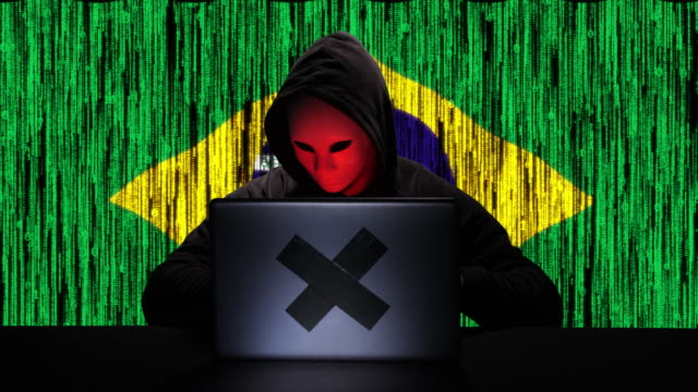 hacker hacking typing code on his laptop with brazil flag and binary code animation overlay in background - tragedy mask stock videos & royalty-free footage