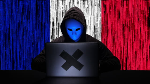 hacker hacking typing code on his laptop with france flag and binary code animation overlay in background - tragedy mask stock videos & royalty-free footage