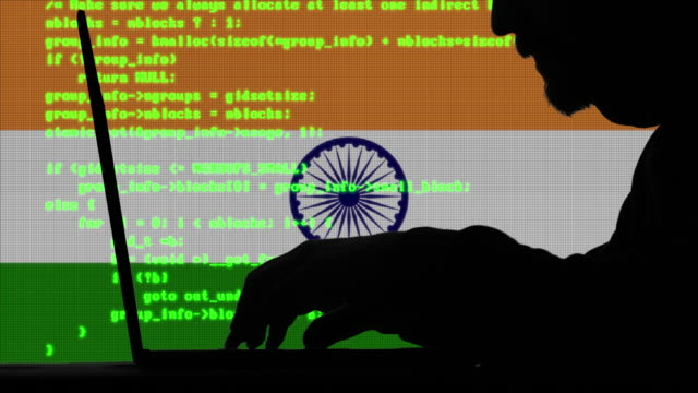 hacker hacking typing code on his laptop with indian flag  in background - computer crime stock videos & royalty-free footage