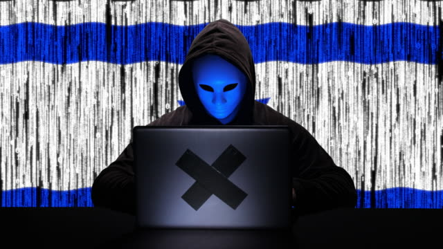 hacker hacking typing code on his laptop with israel flag and binary code animation overlay in background - tragedy mask stock videos & royalty-free footage