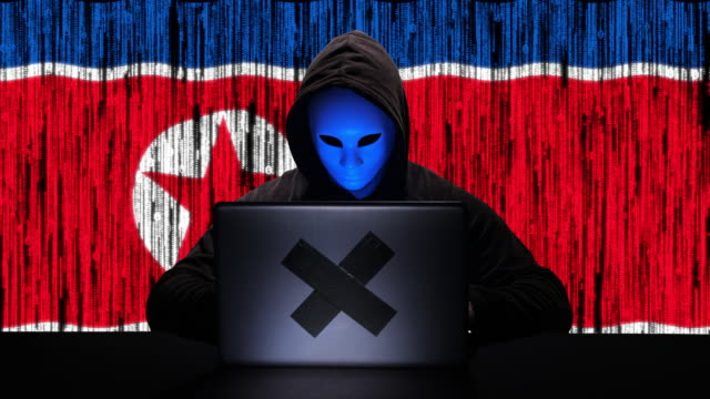 hacker hacking typing code on his laptop with north korea flag and binary code animation overlay in background - north korea stock videos & royalty-free footage