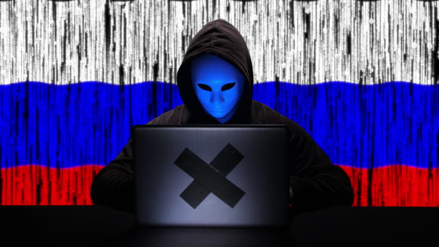 hacker hacking typing code on his laptop with russia flag and binary code animation overlay in background - tragedy mask stock videos & royalty-free footage