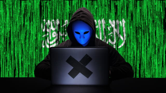 hacker hacking typing code on his laptop with saudi arabia flag and binary code animation overlay in background - tragedy mask stock videos & royalty-free footage