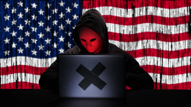 hacker hacking typing code on his laptop with usa flag and binary code animation overlay in background - tragedy mask stock videos & royalty-free footage