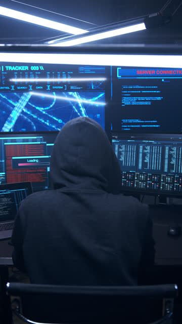 a hacker is working on a malicious virus to launch it into the network. - hat stock videos & royalty-free footage