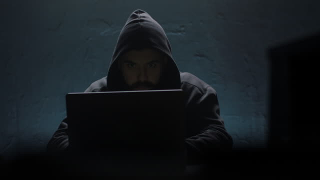 hacker opening laptop - hooded top stock videos & royalty-free footage