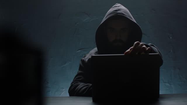hacker opening laptop - contento video stock e b–roll