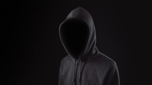 hacker standing alone in dark room - mystery stock videos & royalty-free footage