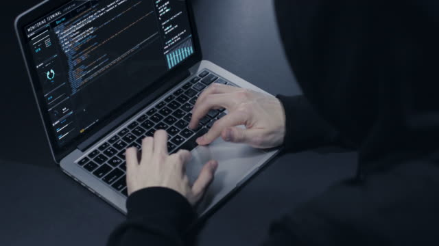 hacker with laptop - computer hacker stock videos & royalty-free footage