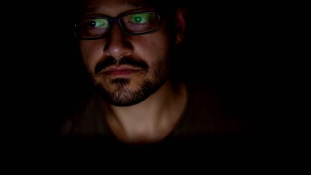 Hacker working in dark