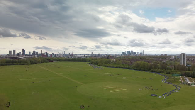 hackney marshes east london. the home of sunday league football with up to 82 football pitches and also cricket pitches - incidental people stock videos & royalty-free footage