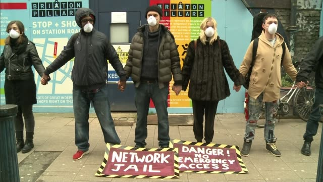 hackney railway arches: business owners hit by soaring rents; t040218001 / tx 4.2.2018 brixton: brixton arches: ext various shots of protesters... - holding hands stock videos & royalty-free footage