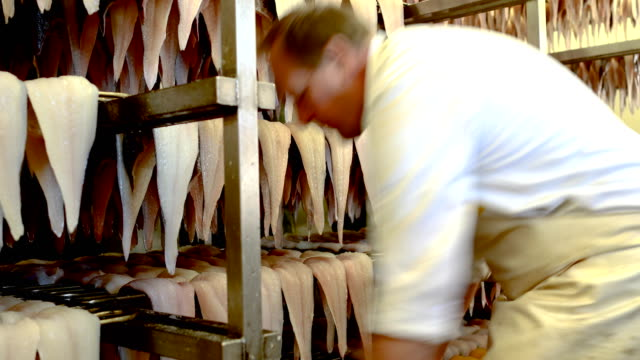 haddock is hung to dry before being hung in the chimney to be smoked at alfred enderby ltd fish smokers on grimsby fish docks on october 8 2018 in... - {{ contactusnotification.cta }} stock videos & royalty-free footage