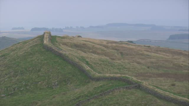 hadrian's wall above hotbank crags - crag stock videos and b-roll footage