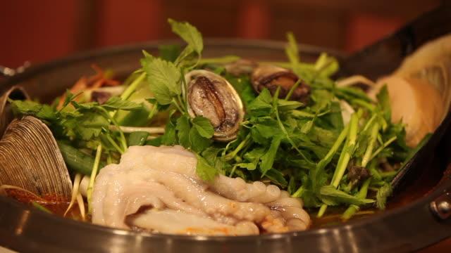 Haemul jeongol (Seafood Hot Pot) being on the boil (Korean food), Jeju Island