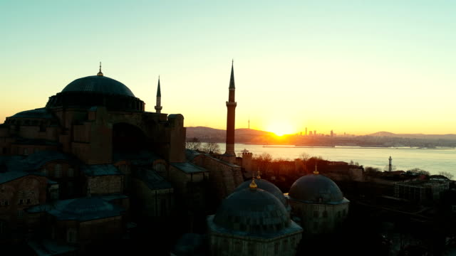 hagia sophia sunrising and birds flying in istanbul - mosque stock videos & royalty-free footage