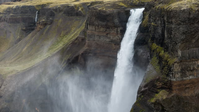Haifoss waterfall dropping down into canyon in Iceland