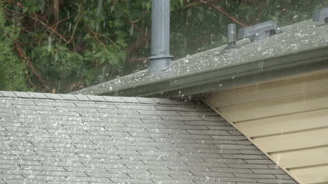 hail falls on house roof shingles denver colorado heavy rain thunderstorm water - roof stock videos & royalty-free footage