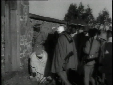 stockvideo's en b-roll-footage met haile selassie visiting camp / ethiopia - 1935