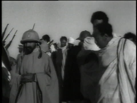stockvideo's en b-roll-footage met haile selassie walking with soldiers while visiting camp / ethiopia - 1935