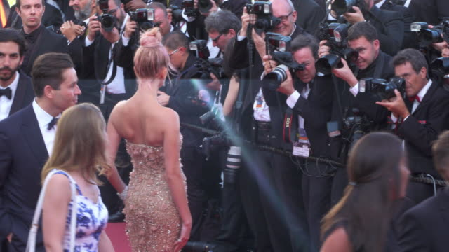 vídeos de stock, filmes e b-roll de hailey baldwin shines on the red carpet during cannes film festival 2018 - 2018
