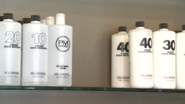 hair care products in salon on september 21, 2011 in san diego, california - shampoo stock videos & royalty-free footage