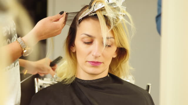hair coloring. close up - beauty salon stock videos and b-roll footage