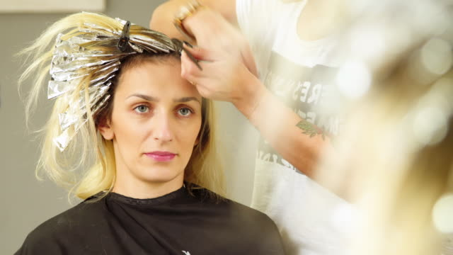 hair coloring. close up - beautician stock videos and b-roll footage