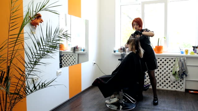 hair coloring. hairdresser is coloring long hair with hair dye. - highlights hair stock videos & royalty-free footage