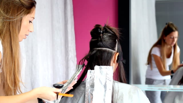 hair coloring - highlights hair stock videos & royalty-free footage