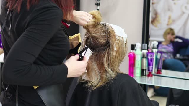 hair colouring in process - highlights hair stock videos & royalty-free footage