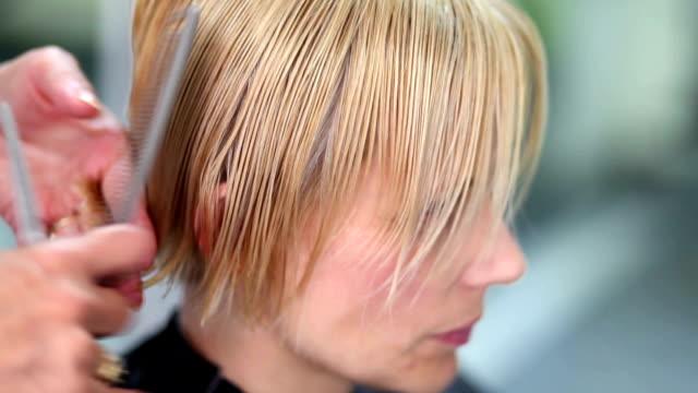 hair cut - cutting hair stock videos and b-roll footage