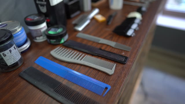 hair cutting equipment in barber shop - hairdresser stock videos & royalty-free footage