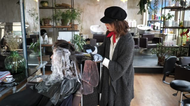 hair dresser is entrepreneur developing her small business - beautician stock videos & royalty-free footage